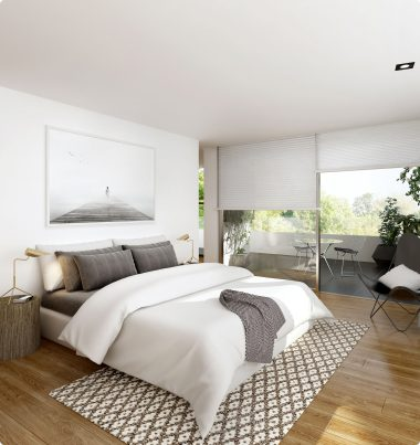 Light bedroom with large windows and half-drawn shades