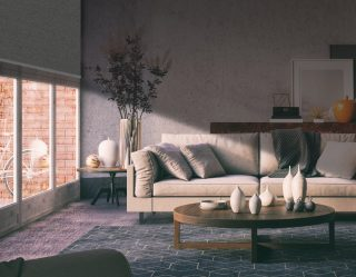 A styling living room with large windows. The blinds are half-drawn, lighting the lower part of the room.